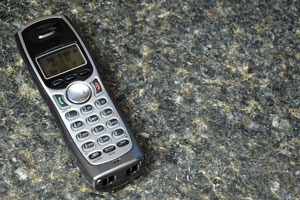 modern cordless phone atop a granite countertop