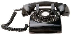 vintage rotary-dial telephone, capable of dialing phone numbers with area codes